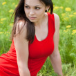 Young pretty woman in red dress — Stock Photo