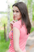 Young pretty woman portrait in park — Stock Photo
