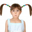 Portrait of funny surprised child girl with long tails on white — Stock Photo #10455749