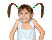 Portrait of funny shoked child girl with long tails on white — Stock Photo