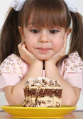 Child girl and cake — Stock Photo