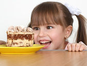 Child girl with cake — Stock Photo