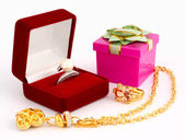 Jewellery and gift box on white background — Stock Photo