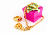 Golden jewelry with gift box on white — Stock Photo