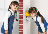 Little twin girls overhears — Stock Photo