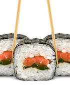 Sushi roll with chopsticks isolated on white — Stock Photo