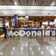 Постер, плакат: Customers having their meals at McDonalds at Madrid airport
