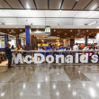 Stock Photo: Customers having their meals at McDonalds at Madrid airport