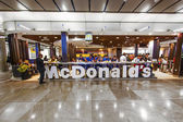 Customers having their meals at McDonalds at Madrid airport — Stock Photo