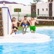 Three boys jumping in the pool — Stok fotoğraf