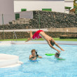 Young photographer takes pictures at the pool — Stock Photo