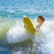 Boy has fun surfing in the waves — Stock Photo #10369747