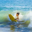 Boy has fun surfing in the waves — Stock Photo #10369795