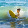 Boy has fun surfing in the waves — Stock Photo #10369802