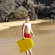 Boy has fun surfing in the waves — Stock Photo #10369862