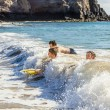 Boys have fun surfing in the waves — Stock Photo #10369868