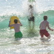 Boys has fun surfing in the waves — Stock Photo