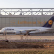 Lufthansa A380 at Lufthansa Technik wharft at Rhein Main airport - Stock Photo
