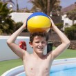 Royalty-Free Stock Photo: Cute boy carrying a plastic ball on his head