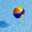 Inflated plastic ball flying in the pool — Stok fotoğraf