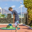 Boy loves to play Mini-Golf - Stock Photo