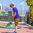 Stock Photo: Boy loves to play Mini-Golf