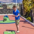 Boy loves to play Mini-Golf — Stock Photo