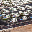 Settlement of new houses all in same style - Stock Photo