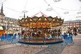 Carrusel para niños en madrid de plaza mayor en navidad tim — Foto de Stock