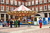 Carousel for children at Madrids Plaza de major in Christmas tim — Stock Photo
