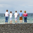 Royalty-Free Stock Photo: Family watches the waves at the  black volcanic beach