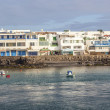 Scenic view to the promenade of Playa Blanca, Lanzarote from sea — Stock Photo #10666280