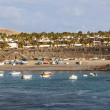 Scenic view to the promenade of Playa Blanca, Lanzarote from sea — Stock Photo #10666291