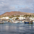 Scenic view to the promenade of Playa Blanca, Lanzarote from sea — Stock Photo #10666433