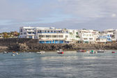 Scenic view to the promenade of Playa Blanca, Lanzarote from sea — Stock Photo