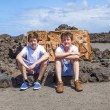 Brothers sitting on a rock and have a rest — Stock Photo