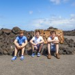 Royalty-Free Stock Photo: Three friends sitting on a rock and have a rest