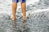 Feet of boy at the beach — Stock Photo