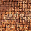 Red stapled bricks give harmonic pattern in sun — Stock Photo #7978758