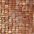 Red stapled bricks give harmonic pattern in sun — Stock Photo #7979009