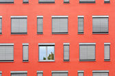 Pattern of windows with red wall — Stock Photo