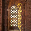 Qutb Minar, Delhi, window gives a beautiful light like stars - Стоковая фотография