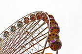 Big wheel in motion with dark clouds — Stock Photo