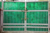 Old closed gate of a house downtown in Delhi — Stock Photo