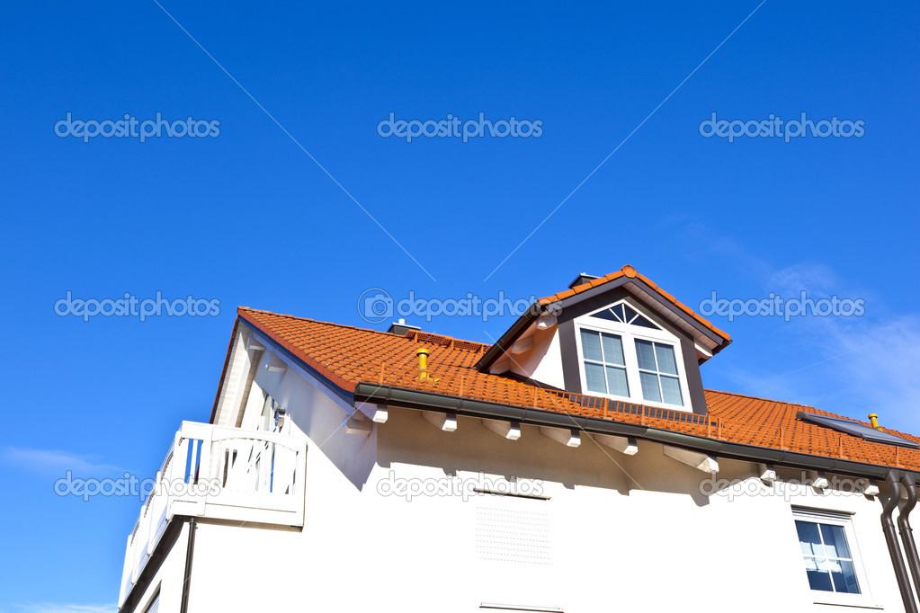 Generic family home in suburban area with blue sky — Stock Photo #8293483