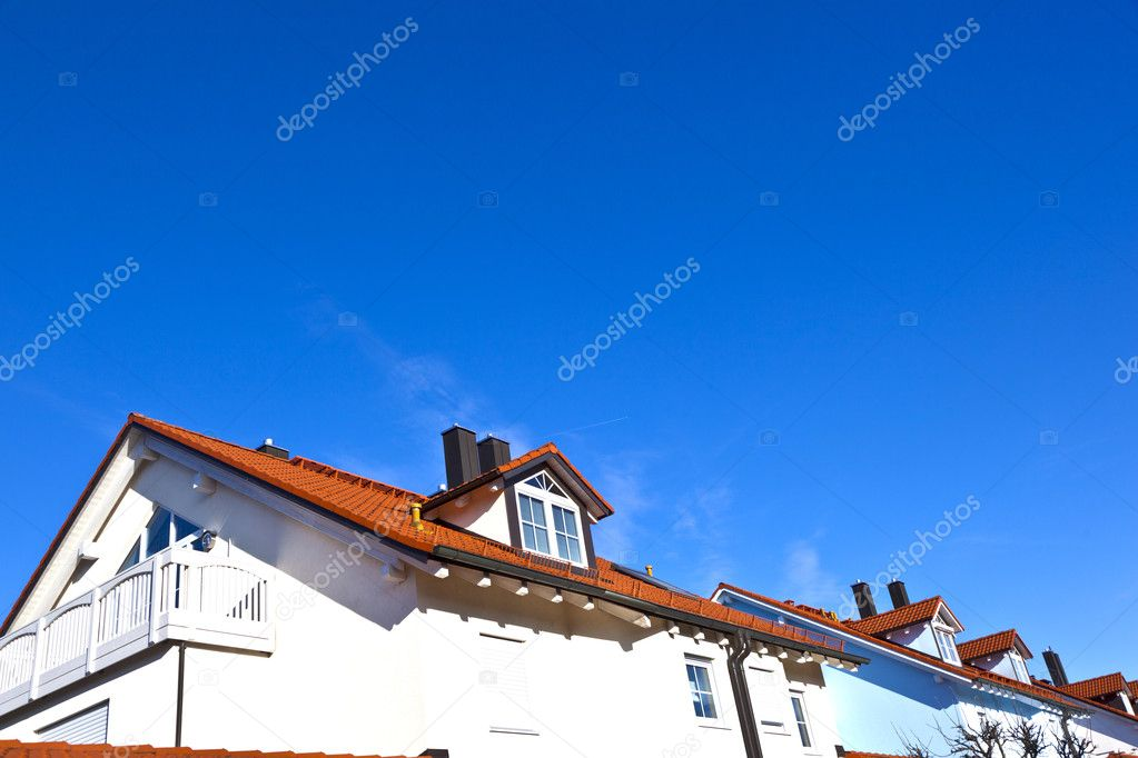Generic family home in suburban area with blue sky — Stock Photo #8293509