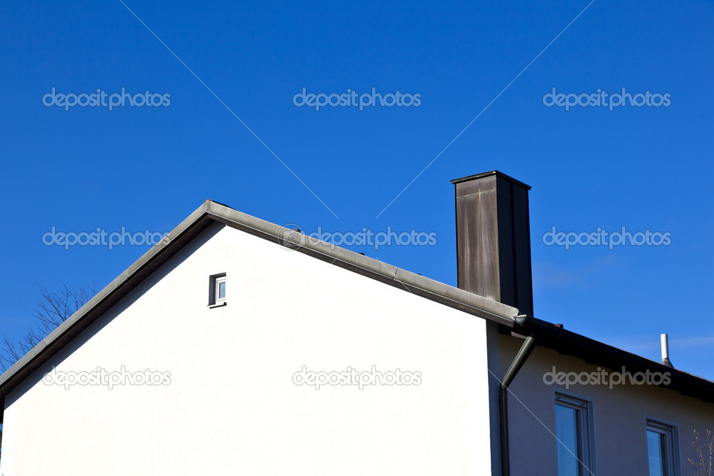 Generic family home in suburban area with blue sky — Stock Photo #8293527