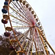 Big wheel in motion with dark clouds — Stock fotografie