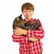 Cute boy hugging with his cat — Stock Photo #8351233