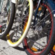 Stock Photo: Bicycle wheels lined up